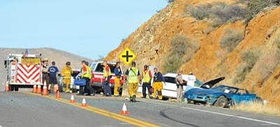 Matt Hinshaw/The Daily Courier<br>Emergency workers begin to clean up the scene of a two-vehicle collision on Highway 169 Wednesday afternoon in Dewey-Humboldt.  Both drivers of the vehicles were transported by helicopter to hospitals in Phoenix.