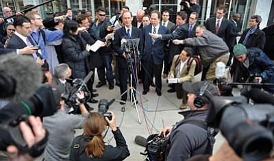 Jim Mone/The Associated Press<br>NFL attorney David Boies, center at microphone, addresses the media outside a federal courthouse after the NFL antitrust lockout hearing Wednesday in St. Paul, Minn. A group of players is asking a judge to issue a preliminary injunction on the lockout the owners imposed after talks on a new collective bargaining agreement broke off three weeks ago.