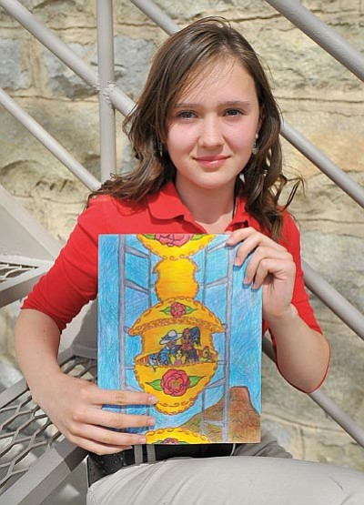 Matt Hinshaw/The Daily Courier<br> Alysda McHale, 11, a fifth-grade student at the Christian Academy of Prescott, holds her winning colored pencil drawing for the annual Yavapai County Fair Book Cover contest Wednesday afternoon. The annual contest had 238 entries from 9 different schools.