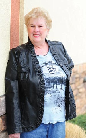 Les Stukenberg/The Daily Courier<br> Connie Kotch of Prescott Valley said a relatively new procedure that thins ligaments to relieve pressure on the nerves in the spinal canal helped her stand upright without pain for the first time in years.