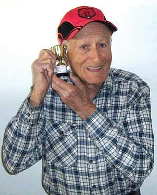 Jerry Jackson/Courtesy photo<br> Nick Davirro shows off his famous bowling trophy.