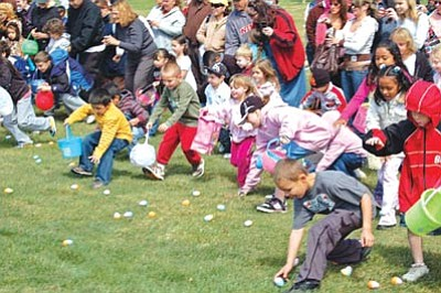 Doug Cook/The Daily Courier<br> Children burst onto a grass field April 4, 2009, to gather pastel-colored plastic eggs at the Civic Center during the Town of Prescott Valley's Eggstravaganza Easter egg hunt.
