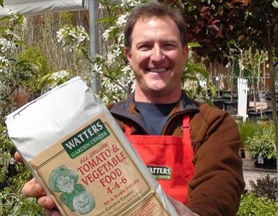 Courtesy photo<br /><br /><!-- 1upcrlf2 -->Ken Lain displays Watters Garden Center's Tomato and Vegetable Food, an organic, granular fertilizer.
