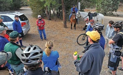 Matt Hinshaw/The Daily Courier<br> Sara and Danny Murray with the Back Country Horsemen talk with members of the Prescott Mountain Bike Alliance about sharing trails Saturday morning at the Cayuse Trailhead in Prescott.