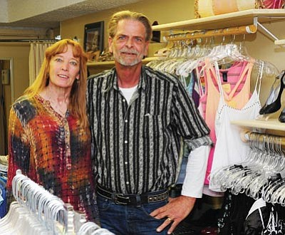 Les Stukenberg/The Daily Courier<br>Steve and Anita Davis, owners of Flipits Exchange at 117 E. Gurley St., Suite 113 where they sell resale fashions.