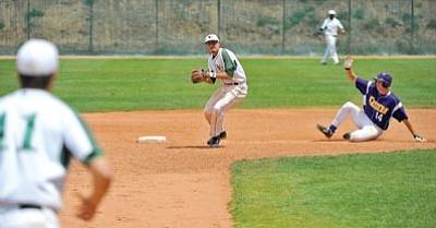 Yavapai College's Albert Alvarez, middle, prepares to throw to Tony Piazza as EAC's Cedric Johnson slides into second base.