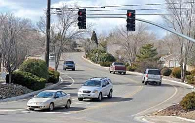 Matt Hinshaw/The Daily Courier<br>Vehicles travel up and down Rosser Street near the intersection of Highway 89 Feb. 2, 2010, in Prescott.