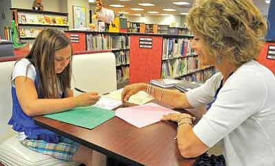 """Matt Hinshaw/The Daily Courier<br>Rachel Irvine, 12, works with her tutor Lissa Howard Thursday afternoon at the Prescott Public Library.  Irvine has dyslexia and recently won second place in the 2011 Youth Poetry Contest for her poem, """"Dyslexia is My Captor."""""""