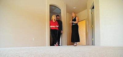 "Les Stukenberg/The Daily Courier<br>Realtor Di Norkus shows her clients, first-time home buyers Brandon and Stacey Roe, a home they hope to buy through a ""short sale"" in Chino Valley on Tuesday."