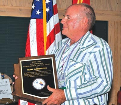 YCSO/Courtesy photo   <br /><br /><!-- 1upcrlf2 -->YCSO Deputy Roial Armstrong holds a plaque honoring him as Coordinator of the Year.