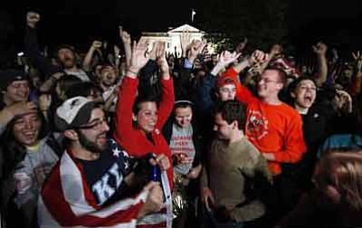 Manuel Balce Ceneta/The Associated Press<br>A crowd outside the White House in Washington cheer Sunday night upon hearing the news that terrorist leader Osama bin Laden is dead.