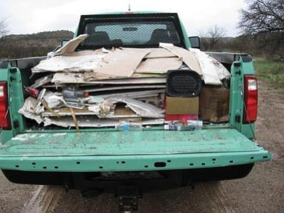 YCSO/Courtesy photo<br> Ramon Meza of Cottonwood reportedly admitted to a Yavapai County sheriff's deputy that he dumped the construction debris pictured above in the Prescott National Forest.