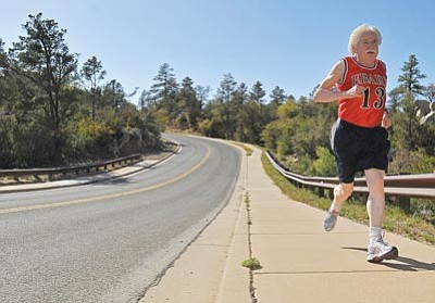 Matt Hinshaw/The Daily Courier<br /><br /><!-- 1upcrlf2 -->Whiskey Row Marathon co-founder Tony Ebarb trains for the upcoming marathon in Prescott.  Ebarb founded the Whiskey Row Marathon with Gerald Brownlow in 1979.
