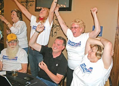 """Salina Sialega/Courtesy photo<br> Members of the """"Chino First"""" political action committee, and KOA spokesman and former Chino Valley Chamber of Commerce president Charlie Arnold, center, cheer after seeing the unofficial Prop. 401 election results online Tuesday night at the Windmill House restaurant in Chino Valley. Prop. 401 unofficially passed with 1,814 yes votes to 802 no votes."""