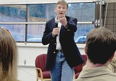 """Felicia Fonseca/The Associated Press<br /><br /><!-- 1upcrlf2 -->Rep. Paul Gosar, R-Ariz., speaks at a town hall meeting in Tusayan. """"Did your own personal health care (concerns) get heard?"""" Gosar asked about 40 people gathered there to hear him. """"No,"""" came the answer. Six months into their jobs, the new representatives are acclimating to their roles, to Congress, to their constituents and to the reality that the 2012 election is under way."""