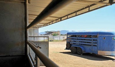 Matt Hinshaw/The Daily Courier<br>A horse trailer packed to the top with items sits in front of empty horse stalls Wednesday afternoon at the Yavapai Downs horse stables in Prescott Valley. These stables were full of horses and bustling with activity Tuesday morning.