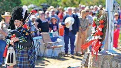"Matt Hinshaw/The Daily Courier<br /><br /><!-- 1upcrlf2 -->A bagpiper plays ""Amazing Grace"" after the wreath-laying at the 2010 Memorial Day ceremony at Citizens Cemetery in Prescott."