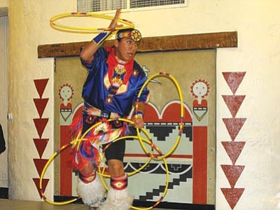 Scott Orr/The Daily Courier<br /><br /><!-- 1upcrlf2 -->Tony Duncan shows the audience why he's the 2011 World Champion hoop dancer Sunday at the 7th annual Smoki Museum Southwest Indian Arts Festival.