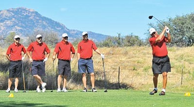 Matt Hinshaw/The Daily Courier<br /><br /><!-- 1upcrlf2 -->Buddy Pate tees off as his three sons, Ted, Tom, and Tim and grandson John look on Saturday morning during the 52nd Annual Father-Son Golf Tournament at Antelope Hills Golf Course in Prescott.<br /><br /><!-- 1upcrlf2 -->