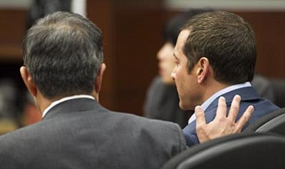 Tom Tingle/The Associated Press<br> Defense attorney Luis Li, left, consoles James Arthur Ray as the verdicts are read in the  courtroom of Judge Warren R. Darrow at Yavapai County Superior Court in Camp Verde June 22.