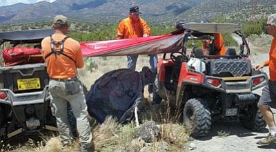 YCSO/Courtesy photo<br> Yavapai County Search and Rescue Team crews create shade for Gary Smith, 62, of Phoenix Tuesday before a medical helicopter arrived. Smith had been lost three days near Strawberry.