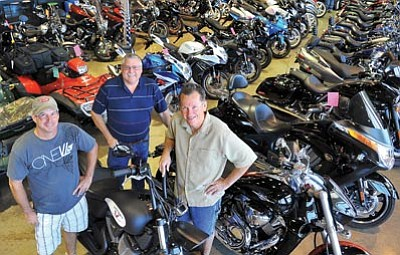 Matt Hinshaw/The Daily Courier<br>From left, Scott Walz, Glenn Crossno and Gary Hengeveld owners of Star Island Motorsports stand together on their showroom floor Wednesday morning in Prescott Valley.  Walz, Crossno and Hengeveld recently bought Prescott Valley Motorcycles to expand their current business.