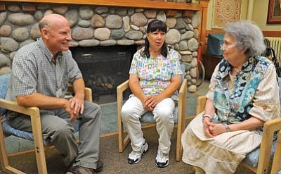 Matt Hinshaw/The Daily Courier<br>Arizona Pioneers' Home Superintendent Ted Ihrman and Director of Nurses Barbara Jimenez talk with resident Betty Gardner about the history of Prescott and her family's role in it Tuesday morning.