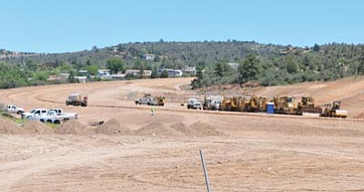 Les Stukenburg/The Daily Courier<br>Paving work is underway on a road that will connect highways 69 and 89 in Prescott, although it's not likely to open until 2012.