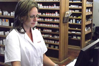 Mark Duncan/The Daily Courier<br> Pharmacist Amy Kille uses the state-run prescription monitoring system whenever she or any of the other pharmacists at Prescott's Goodwin Street Pharmacy suspect the possibility of abuse. The system is currently used at only 11-12 percent of its capability.