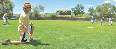 Photos by Matt Hinshaw/The Daily Courier<br /><br /><!-- 1upcrlf2 -->Former Yavapai College infielder Tony Piazza tosses a ground ball to a athlete during a Yavapai College Summer Baseball Camp Wednesday afternoon in Prescott.