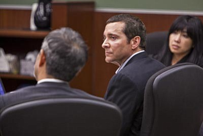 Jack Kurtz/The Associated Press<br> James Ray sits in court with his lawyers Luis Li, left, and Truk Do during his trial March 2 in Camp Verde, Ariz.