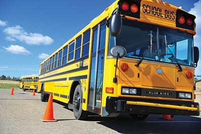 Les Stukenberg/The Daily Courier<br> Bus drivers from Prescott Unified School District participate in the annual bus rodeo at Pioneer Park Monday morning. The drivers will start picking up children around the area as schools start Wednesday.