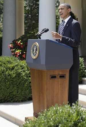Carolyn Kaster/The Associated Press<br> President Barack Obama delivers a statement in the Rose Garden of the White House in Washington Tuesday following the Senate's passing of the debt ceiling agreement.