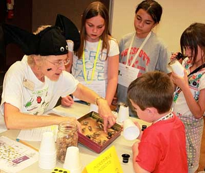 HCNH/Courtesy<br>Highlands Center Docent Joan Dukes leads a Bug-A-Boo Bliss insect discovery session.