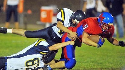Les Stukenberg, File/The Daily Courier<br /><br /><!-- 1upcrlf2 -->Mayer's David Atkerson dives past an opponent during the 2010 season.