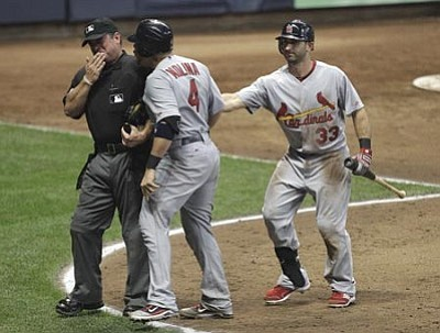 AP Photo/Morry Gash<br /><br /><!-- 1upcrlf2 -->St. Louis Cardinals' Yadier Molina is restrained by teammate Daniel Descalso (33) as he argues with home plate umpire Rob Drake after being called out on strikes during the 10th inning of a baseball game against the Milwaukee Brewers Tuesday, Aug. 2, in Milwaukee. <br /><br /><!-- 1upcrlf2 -->