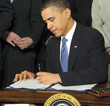 J. Scott Applewhite/The Associated Press<br> In this March 23, 2010, file photo, President Barack Obama signs the healthcare bill in the White House in Washington. A federal appeals court panel struck down the requirement in President Barack Obama's health care overhaul package that virtually all Americans must carry health care insurance or face penalties.