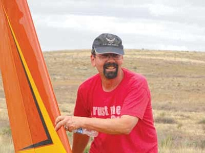 Scott Orr/The Daily Courier<br>Bill Thrift set his glider down in one piece in a field Sunday.