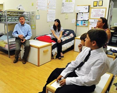 Les Stukenberg/The Daily Courier<br> United States Congressman Paul Gosar talks to residents, staff and directors of the Prescott Area Women's Shelter Monday afternoon.