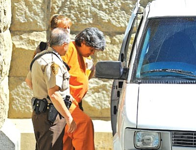 Matt Hinshaw/The Daily Courier<br> Yavapai County Sheriff's Office deputies help Elise Townsend into a transfer vehicle after her probation violation hearing at the Yavapai County Courthouse June 3.