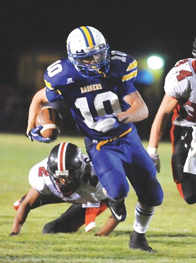 Les Stukenberg/The Daily Courier, file<br /><br /><!-- 1upcrlf2 -->Prescott's Brady Mengarelli runs between a trio of Bradshaw defenders during the annual football rivalry game between Prescott and Bradshaw Mountain on Friday night in Prescott.