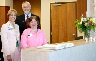 Sue Tone/Courtesy photo<br> Standing behind the reception desk at the new YRMC East BreastCare Center in Prescott Valley are, from left, Clinical Navigator Nancy Ledoyen, YRMC Director and CEO Tim Barnett, and receptionist Jacquie Peterson.