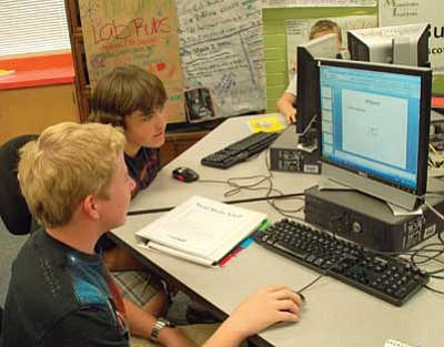 Lisa Irish/The Daily Courier<br> James Crane, sophomore, left, and Josh Armes, sophomore, right, work on a social media project during their information technology class Thursday afternoon at Prescott High School.