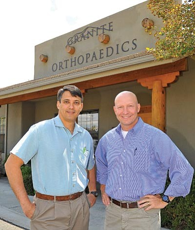 Matt Hinshaw/The Daily Courier<br>Paul Pflueger, M.D., and Spencer Schuenman, D.O., opened the doors to their practice, Granite Orthopaedics, in November of 2010 in Prescott.