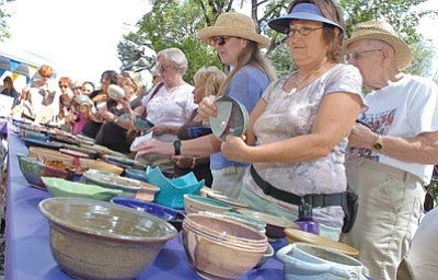 File photo/The Daily Courier<br> Hannah Hunter, right, looks for just the right bowl at a previous Empty Bowls event.