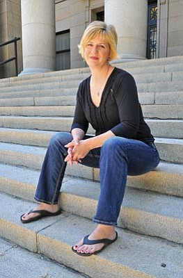 Matt Hinshaw/The Daily Courier<br>Dina Mountcastle sits on the Yavapai County Courthouse steps Wednesday morning in Prescott. Mountcastle is one of the speakers at this Sunday's 9-11 remembrance ceremony. She was exiting a subway in New York when the World Trade Center buildings were hit.