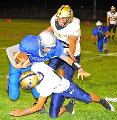 Matt Hinshaw/The Daily Courier, file <br /><br /><!-- 1upcrlf2 -->Quarterback Josh Custodio dives over a Parker player during the 2010 season on Oct. 15, in Chino Valley. The Cougars lost 19-7.