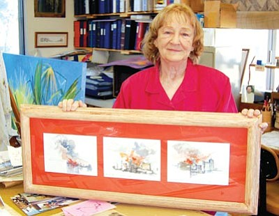 Jason Soifer/The Daily Courier<br>  Artist Bonnie Casey displays her artwork of the 9/11 terrorist attacks at her Chino Valley studio. Casey still gets emotional talking about the horrific events of that day.