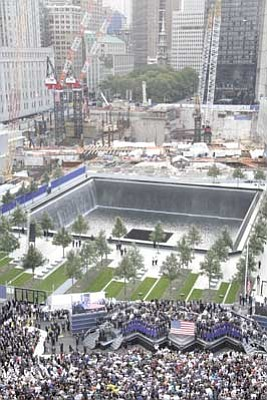 Mark Lennihan/The Associated Press<br>The World Trade Center ceremony takes place at the National September 11 Memorial marking the 10th anniversary of the attacks Sunday in New York.