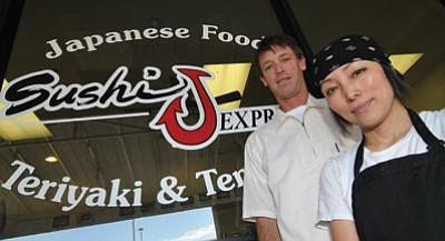 Les Stukenberg/The Daily Courier <br>Justin Johnson and his wife  Noriko pose at their Sushi J Express restaurant in the Safeway shopping center at 7840 E. Highway 69 in Prescott Valley.